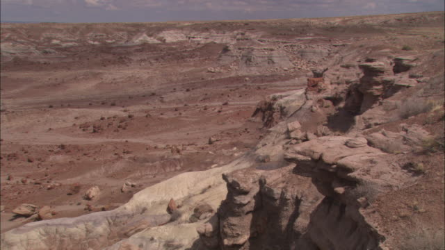 a man walks along a trail in petrified forest national park. - arizona stock videos & royalty-free footage