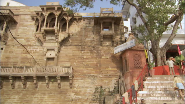 ms td man walks down steps in ganga river / varanasi, uttar pradesh, india - semi dress stock videos and b-roll footage