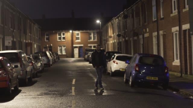 man walks down street at night leather jacket hoodie dark city winter - despair stock videos & royalty-free footage