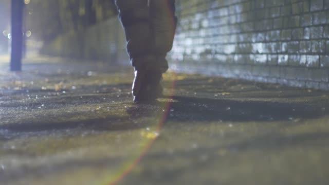 man walks down street at night leather jacket hoodie dark city winter - hooded top stock videos & royalty-free footage