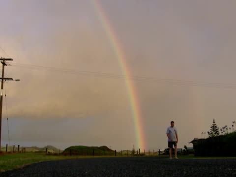 man walks from double rainbow - one mid adult man only stock videos & royalty-free footage