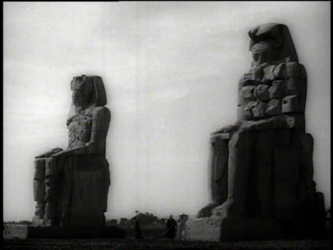 1938 ws man walks in front of row of carved lion statues / egypt - egyptian culture stock videos & royalty-free footage