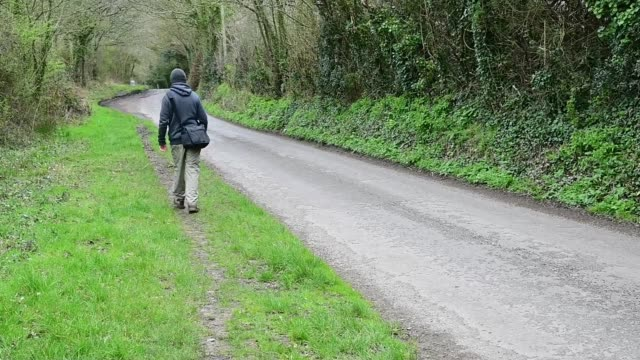 man walks in the countryside - walking in water stock videos & royalty-free footage