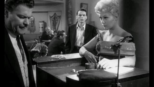 1955 man (frank sinatra) walks into nightclub where friend (kim novak) works - film noir style stock videos and b-roll footage