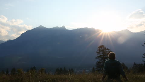 man walks out view sunset, from mountain meadow - one mature man only stock videos & royalty-free footage