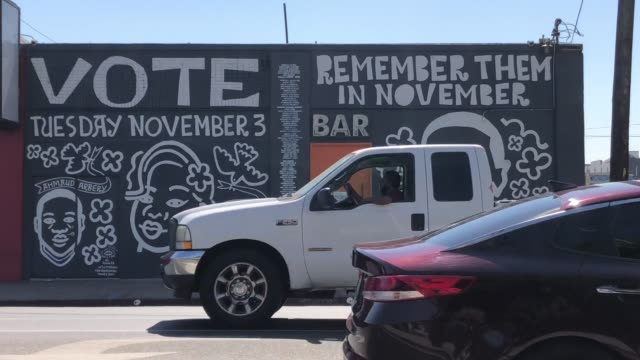 los angeles california october 2 2020 a man walks past a mural by artist eric junker which reads 'vote remember them in november' and features images... - mural stock videos & royalty-free footage