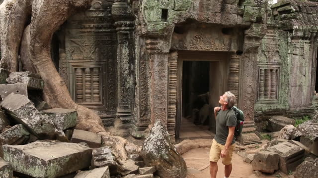 man walks through ancient ruins, in awe - old ruin stock videos & royalty-free footage