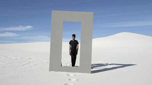man walks through doorframe in desert, wide - full length stock videos & royalty-free footage