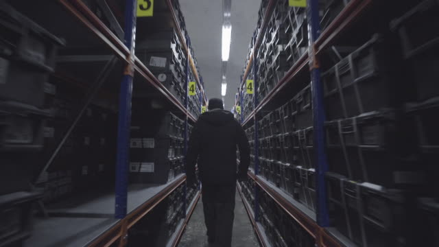 Man walks through Global Seed Vault storage facility