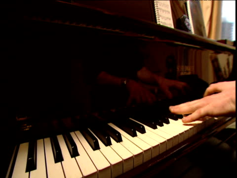 man walks up to piano opens it plays briefly closes piano again and walks away - lid stock videos and b-roll footage