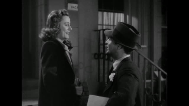 1941 Man (Cary Grant) walks woman (Irene Dunne) home and is invited in
