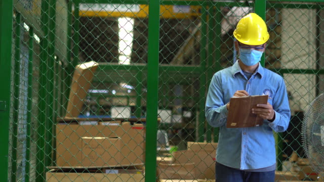 man warehouse manager checking inventory - protective workwear stock videos & royalty-free footage