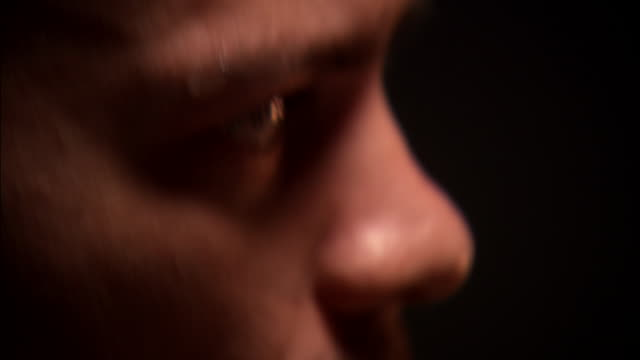 a man warily looks around as sweat beads up on his forehead. - suspicion stock videos & royalty-free footage