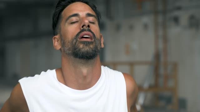 man warming up before exercising - inarcare la schiena video stock e b–roll