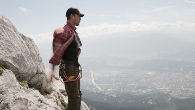 man warming up for slacklining on a highline in the alps