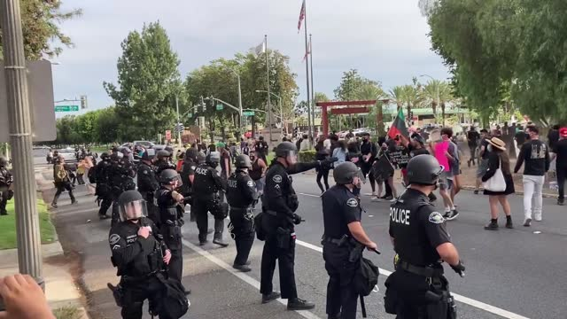 man was arrested after brandishing an assault rifle during a confrontation with protesters in upland, california, on june 1. jacob bracken was... - https stock-videos und b-roll-filmmaterial