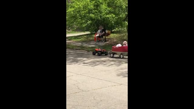 man was spotted giving a child a ride in a wagon pulled by a remote control toy car in boston, massachusetts, on may 13. video footage by gregory... - remote control stock videos & royalty-free footage