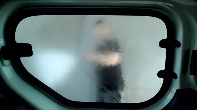 a man washes a car in a self-service car wash. - inside of stock videos & royalty-free footage