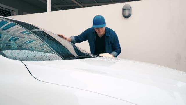man washing a white car. - wax stock videos & royalty-free footage