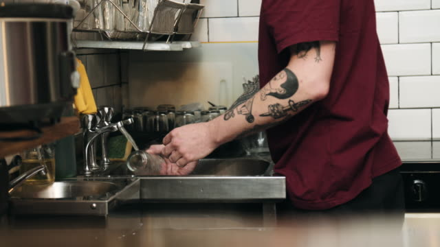 man washing dishes - one mid adult man only stock videos & royalty-free footage