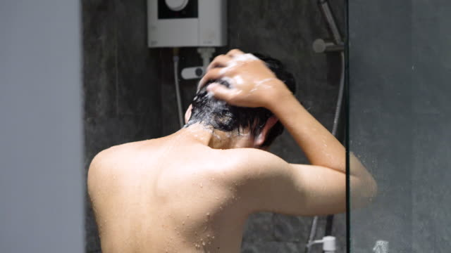 a man washing hair cleansing shampoo - shower curtain stock videos and b-roll footage