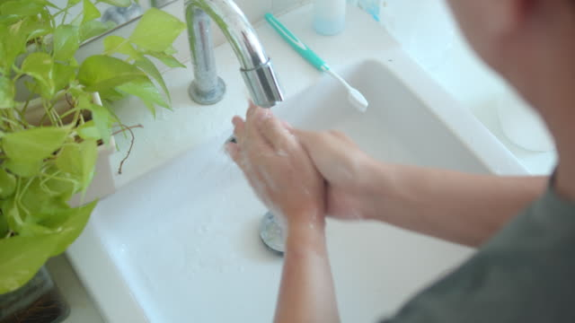 man washing hands in bathroom - bathroom sink stock videos & royalty-free footage