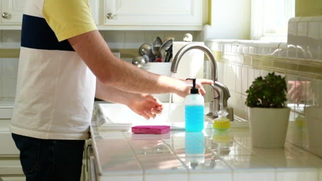 man washing hands in the kitchen sink - only men stock videos & royalty-free footage