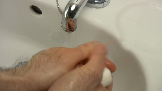 man washing hands - bar of soap stock videos and b-roll footage