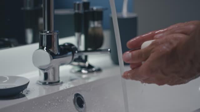 man washing hands - washing face stock videos & royalty-free footage