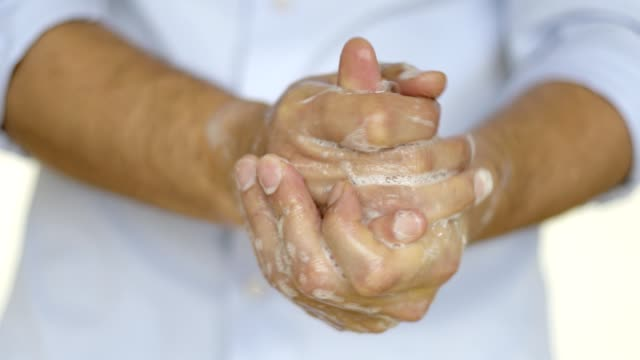 man washing hands with soap - soap sud stock videos & royalty-free footage