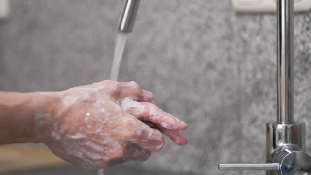 man washing his hands in a sink - responsibility stock videos & royalty-free footage