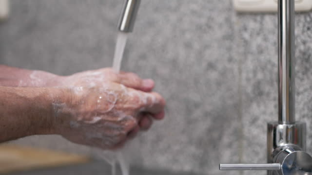man washing his hands in a sink - sink stock videos & royalty-free footage