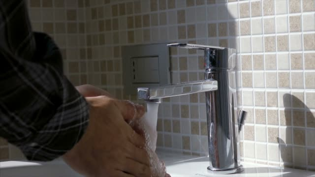 man washing his hands - mosaic stock videos & royalty-free footage