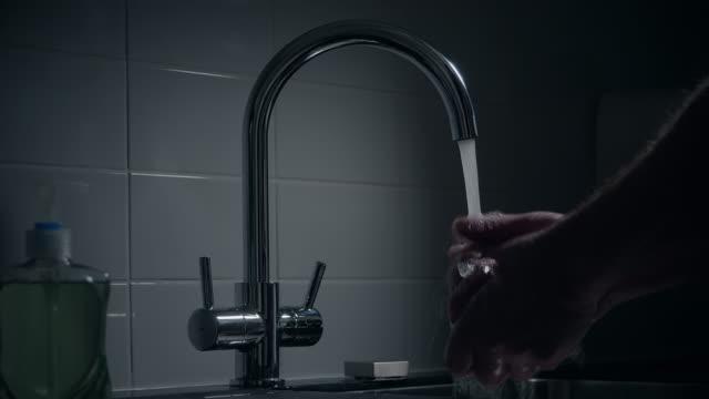 Man washing his hands.