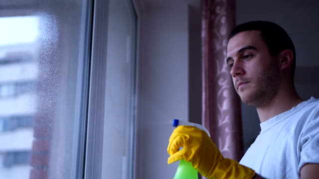 Man washing window with protective gloves