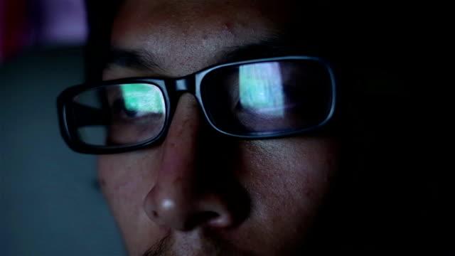 Man watch movie in the dark