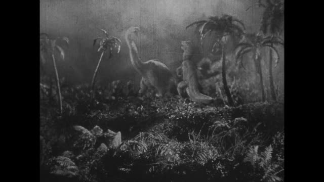 1925 man watches as dinosaurs flee erupting volcano - 1925 stock videos & royalty-free footage