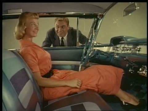 vídeos de stock e filmes b-roll de 1957 man watches as woman in front seat of chevrolet impala looks around smiling - comércio consumismo