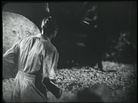 b/w 1954 rear view man (peter graves) watches giant cockroach or beetle - 1954 stock videos & royalty-free footage