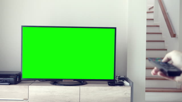 man watches television green screen - television chroma key stock videos & royalty-free footage