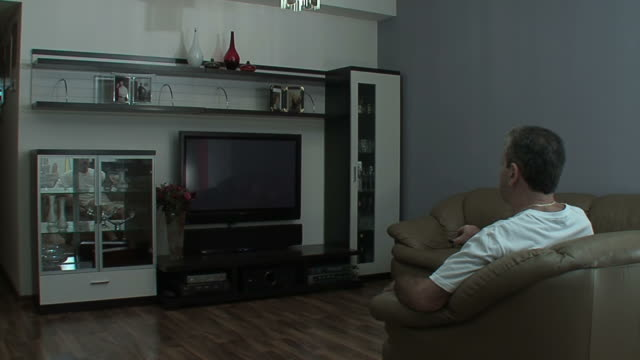 Man watches TV in the sitting room
