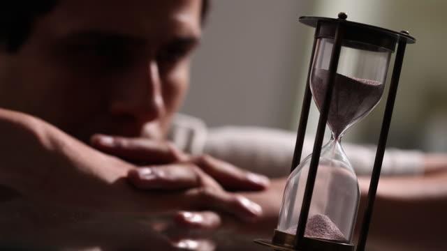 Man watching a hourglass