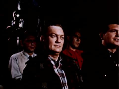 1956 ms ds. man watching film in darkened conference room with other men / usa - biosalong bildbanksvideor och videomaterial från bakom kulisserna