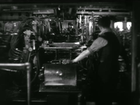 b/w 1936 man watching machines perform auto assembly in chevrolet car factory - robotics stock videos & royalty-free footage