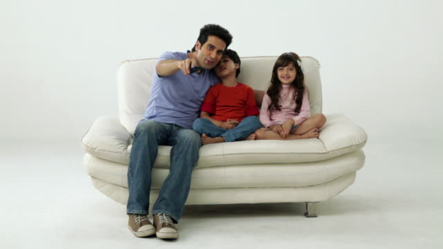 Man watching television with his children