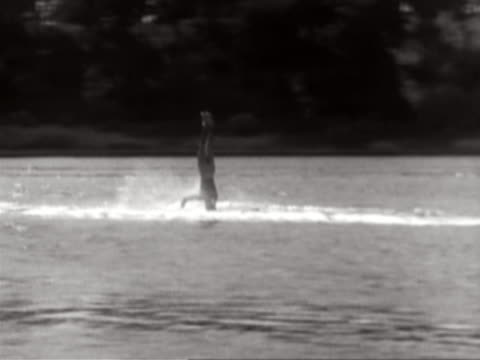 stockvideo's en b-roll-footage met man water-skiing on his head - archief