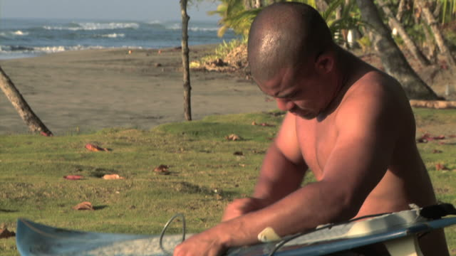 man waxing his surfboard - see other clips from this shoot 1157 stock videos & royalty-free footage