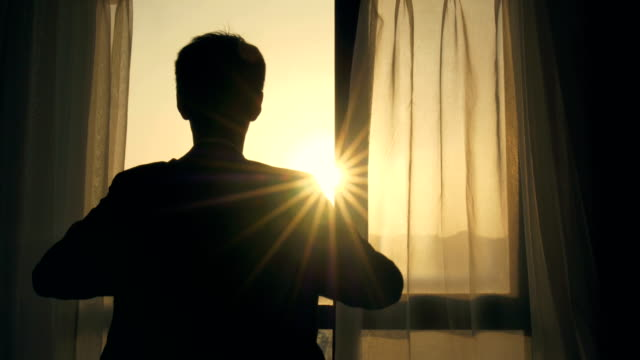 man wear his jacket in the morning - sunrise dawn stock videos & royalty-free footage