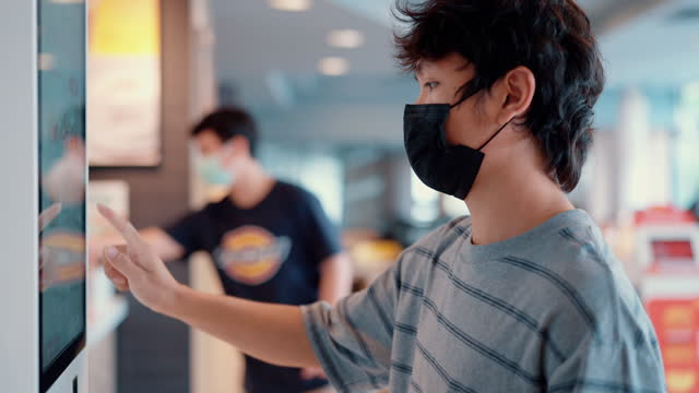 man wear surgical mask paying with smartphone to vending machine. - touch sensitive stock videos & royalty-free footage
