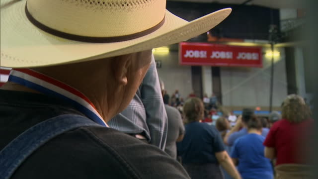 man wearing a cowboy hat listens to u.s. president donald trump speak during a rally in lake charles, louisiana. - over the shoulder stock videos & royalty-free footage